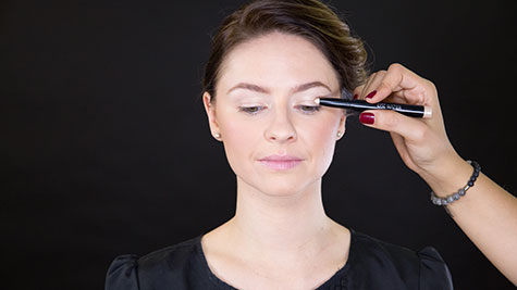 Apply a long-lasting champagne cream eyeshadow